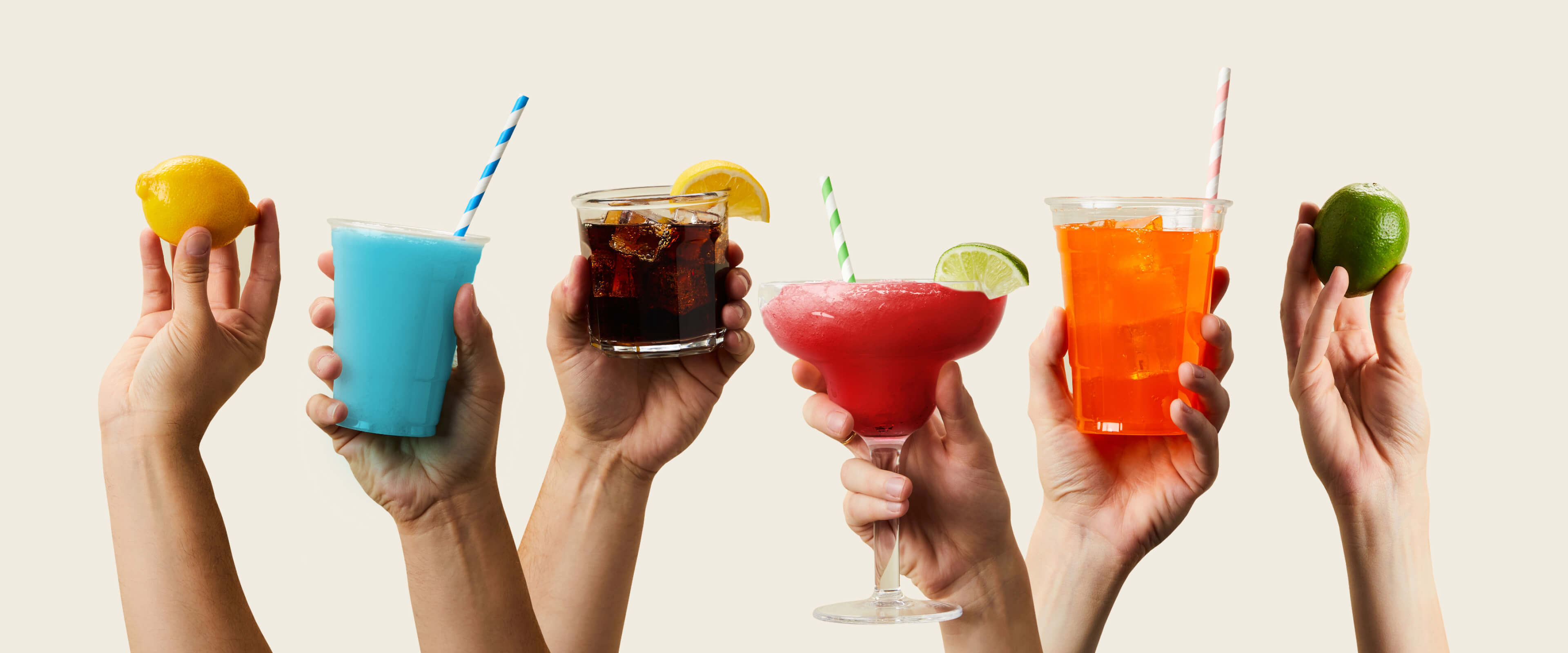 Lots of hands toasting with glasses of colorful drinks